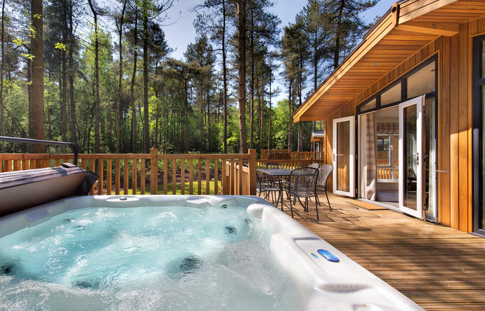 large hot tub on lodge veranda