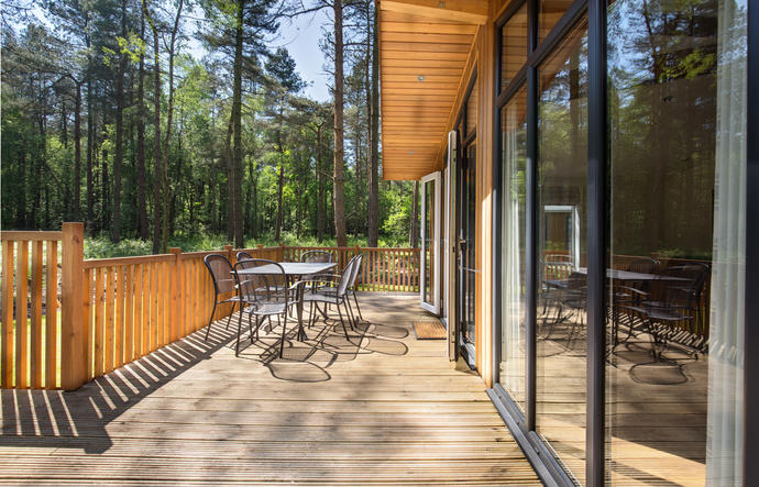 Lodge veranda with outdoor dining furniture