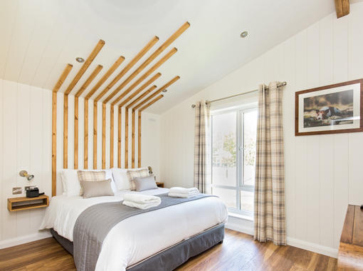 Double bed with wood feature headboard