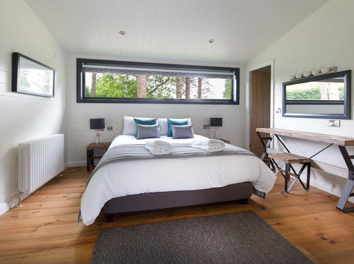 Double bedroom with feature window behind bed