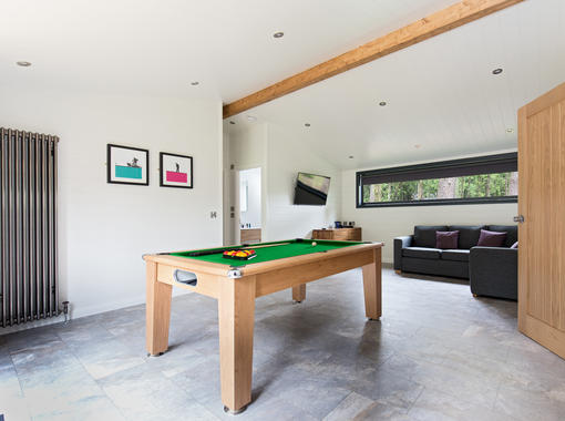 Large games room with pool table and sofa for relaxing