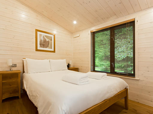 Comfortable double bedroom with crisp white bedding