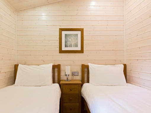 Comfortable twin bedroom with crisp white bedding