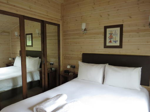 Comfortable double bedroom with built in wardrobes with mirrored doors