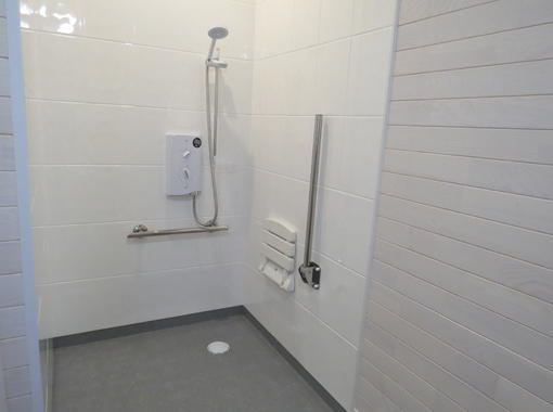 Wet room shower with drop down seat