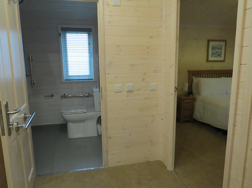Hall way showing space for wheelchair access to the wet room and double bedroom