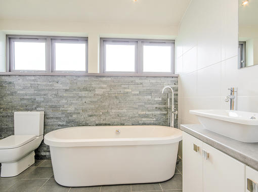 Spacious family bathroom with freestanding bath