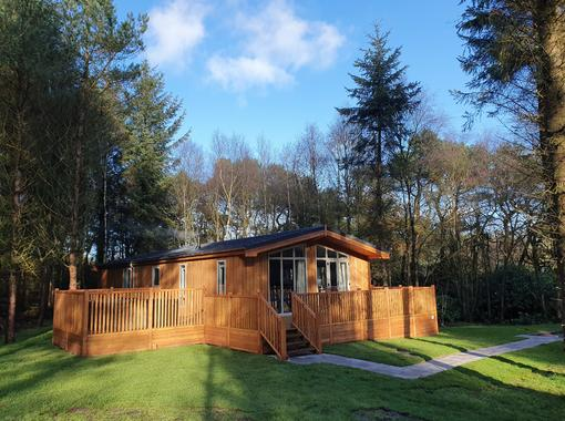 Spinney lodge nestled with in the trees with large verandah