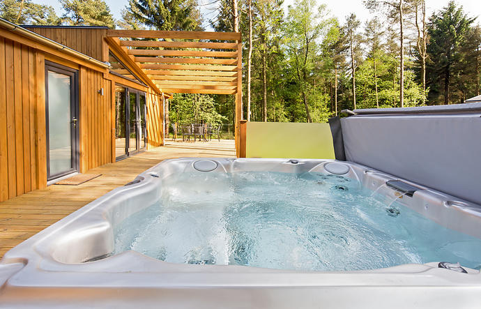 Huge hot tub  with trees behind
