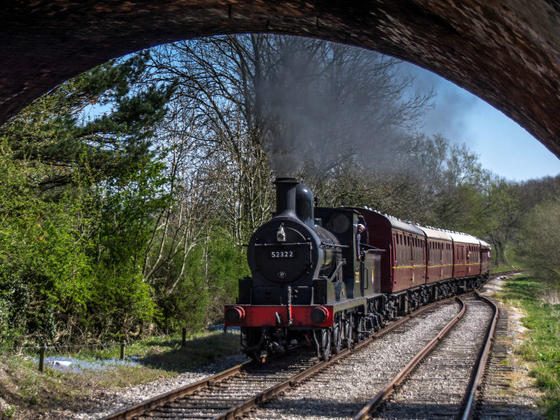 Steam engine approaching a tunnel