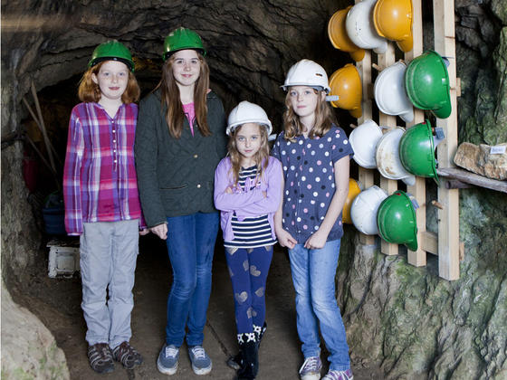 Children in hard hats at the peak district mining museum
