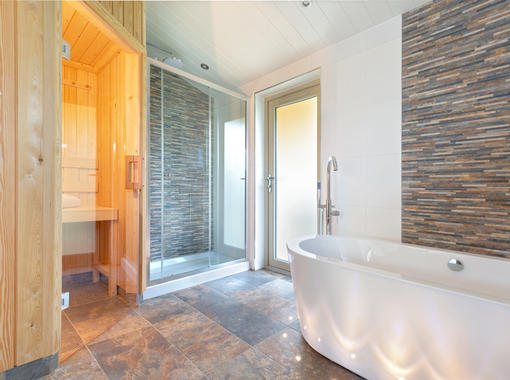 stylish bathroom with large freestanding bath, sauna and large shower cubicle