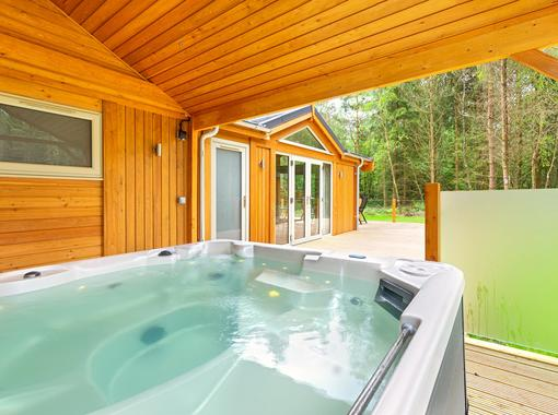 Outdoor hot tub under wooden canopy