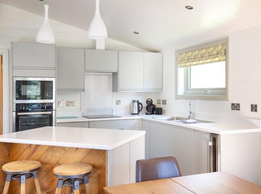 Stylish kitchen with integrated appliances and island unit. breakfast bar to seat 2 people