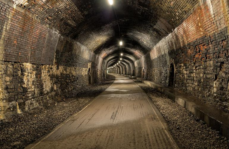 Old lit railway tunnel to walk or cycle through on the monsal trail