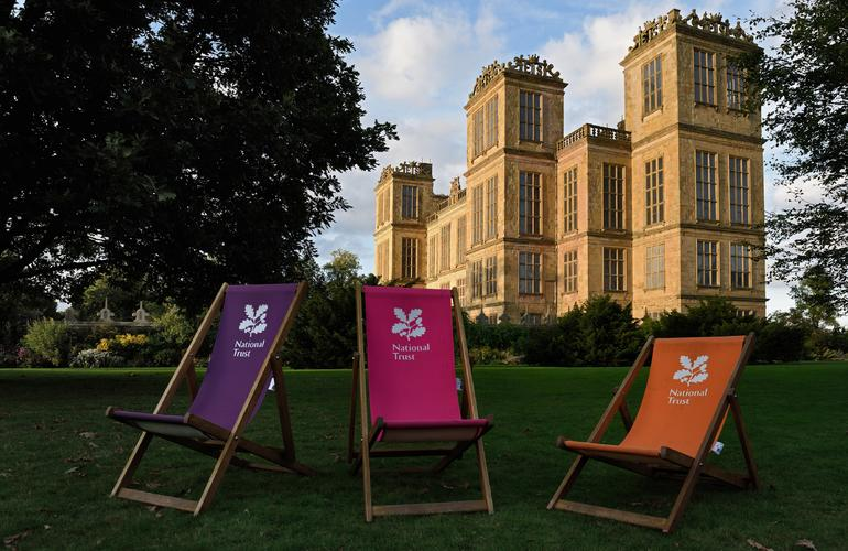 NAtional Trust deckchairs outside Hardwick Hall