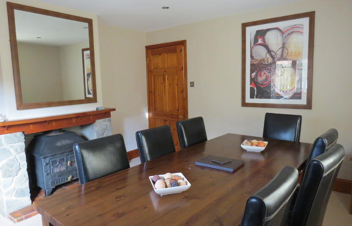 Dining table with fireplace behind