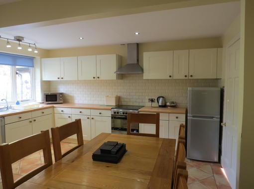 Spacious kitchen area with dining table