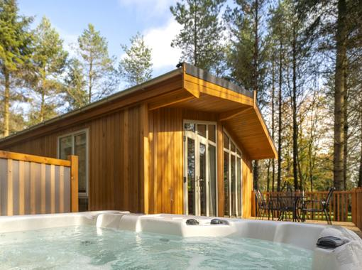 View of lodge exterior from bubbling outdoor hot tub