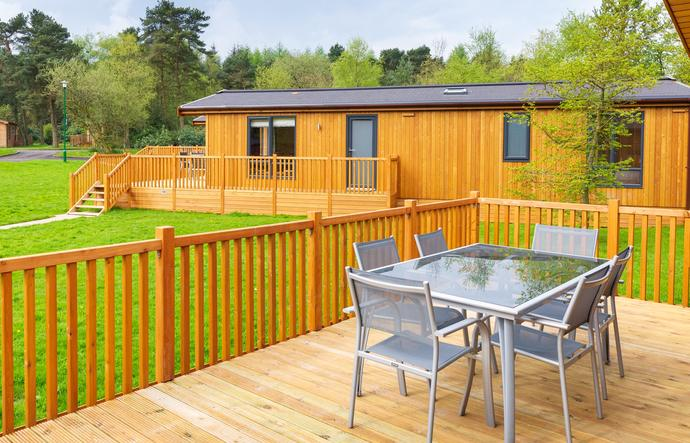 Outdoor seating area looking on to a lodge
